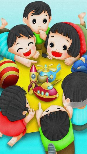 六一儿童节小朋友们快乐围在桌边图片