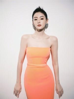 张天爱橘色抹胸长裙简约利落曼妙好身材照片
