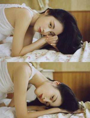 章乐韵吊带白裙妩媚文艺写真图片