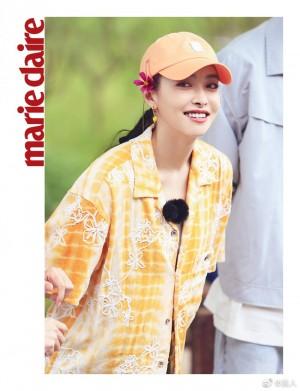 宋茜橘色衬衫棒球帽夏日元气活力写真图片